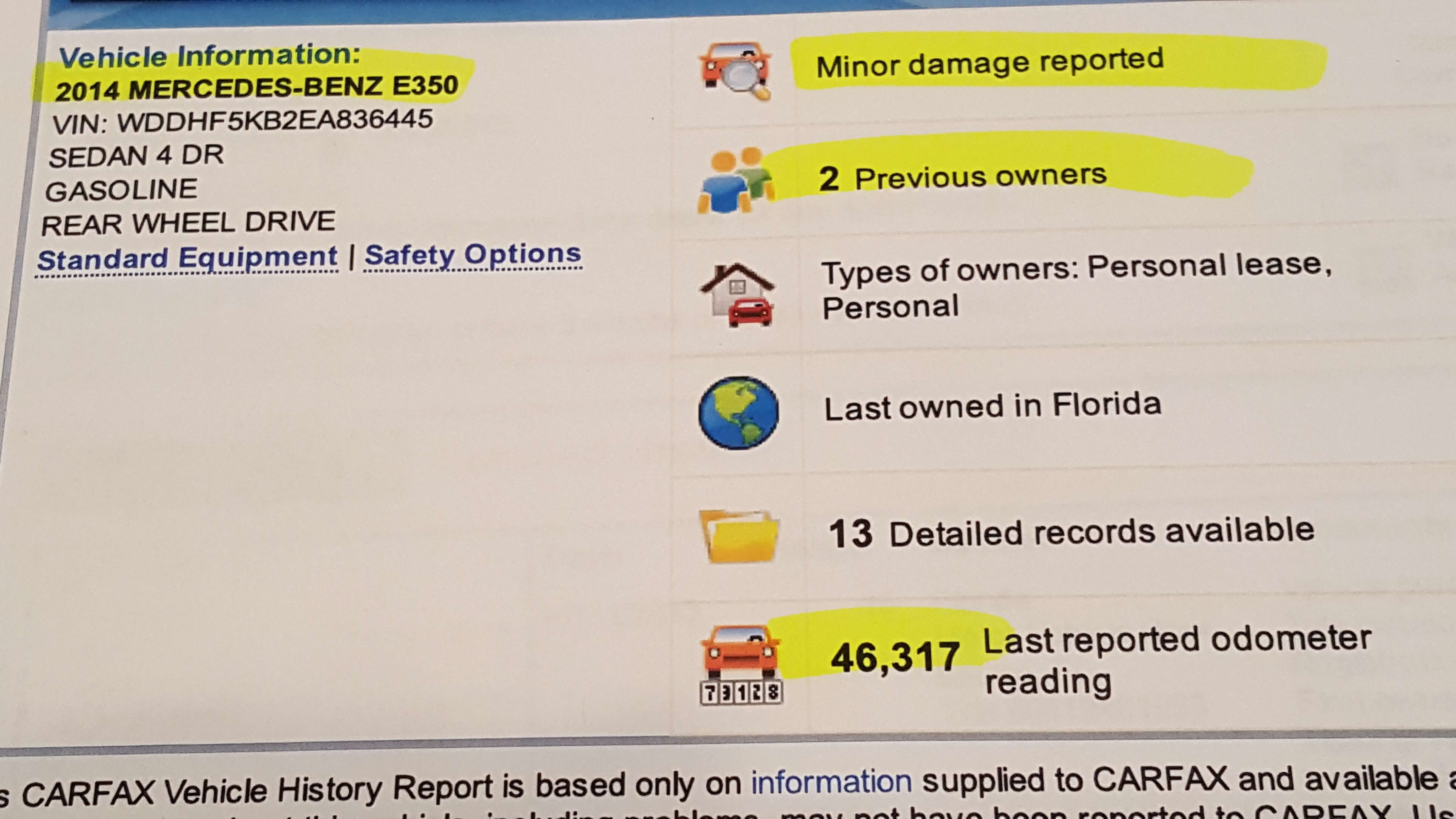 Summary of vehicle history report shows minor accident, 2 previous owners, high mileage