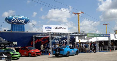 Barrett-Jackson - Ford's Ride 'N Drive booth packed with visitors