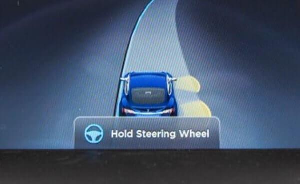 tesla autopilot warning display